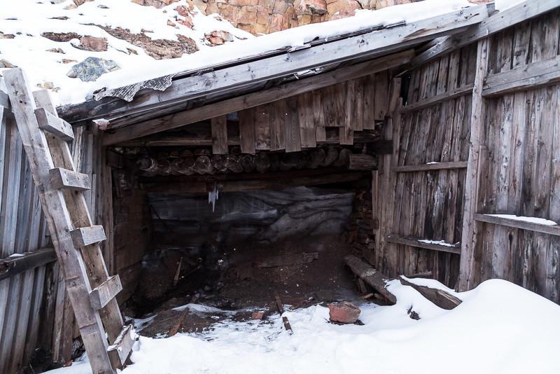 Mineshaft entrance, long sealed by bricks and ice.