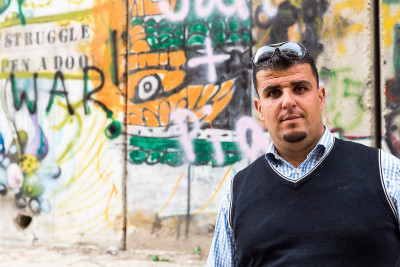 Ala'a, the taxi driver outside the separation wall.