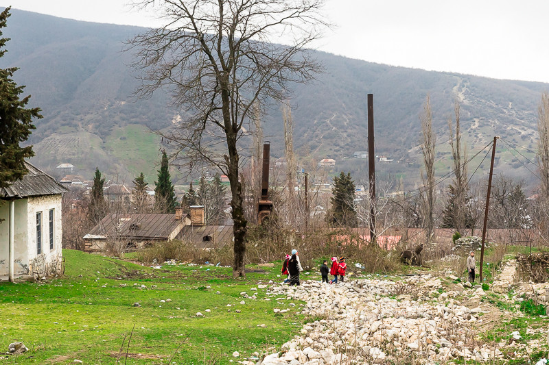 Children playing on the grounds of an abandoned children's hospital in Sheki, Azerbaijan.